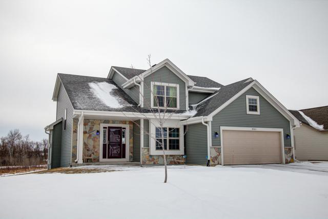 N8063 Woody Ln, Ixonia, WI 53036 (#1624758) :: RE/MAX Service First Service First Pros