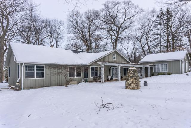 W292N2051 Elmhurst Dr, Delafield, WI 53072 (#1625969) :: RE/MAX Service First Service First Pros