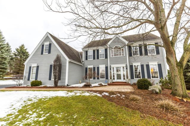 W296N1763 Hidden Creek Ct, Delafield, WI 53072 (#1626661) :: RE/MAX Service First Service First Pros