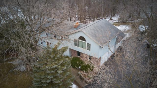 S77W32784 Country Ln, Mukwonago, WI 53149 (#1626662) :: RE/MAX Service First Service First Pros