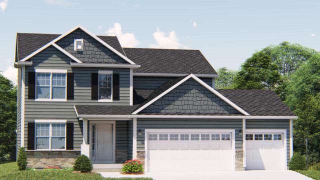 205 Farmstead Dr., Slinger, WI 53086 (#1630948) :: Tom Didier Real Estate Team
