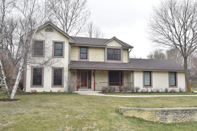 9740 W Huntington Dr, Mequon, WI 53097 (#1631052) :: eXp Realty LLC