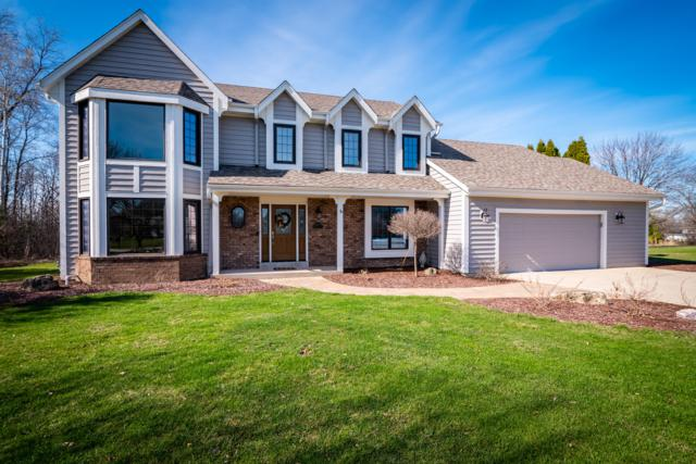 8124 W Ridgeway Ave, Mequon, WI 53097 (#1632027) :: Tom Didier Real Estate Team