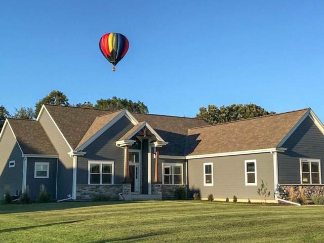N70W27682 Leslie Ln, Merton, WI 53029 (#1634342) :: Tom Didier Real Estate Team