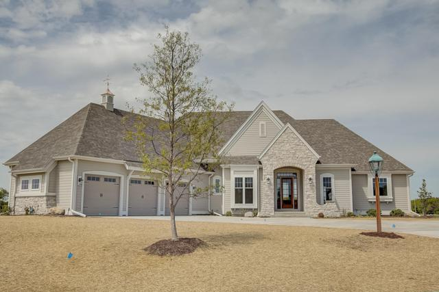 N18W24696 Still River Dr, Pewaukee, WI 53072 (#1637100) :: RE/MAX Service First Service First Pros
