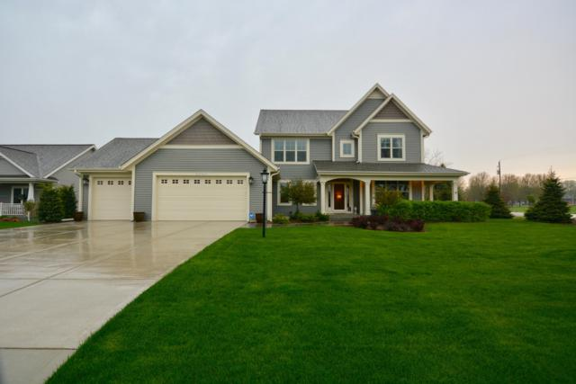 W220N4799 Woodleaf Way, Pewaukee, WI 53072 (#1637288) :: RE/MAX Service First Service First Pros
