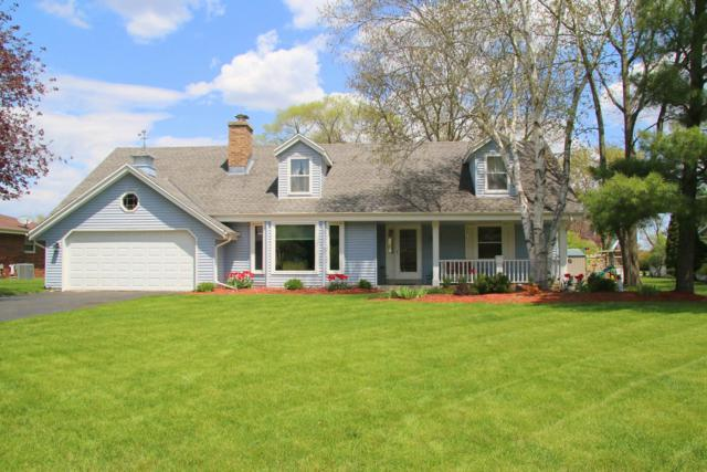W223N2328 Meadowood Ln, Pewaukee, WI 53186 (#1637326) :: RE/MAX Service First Service First Pros