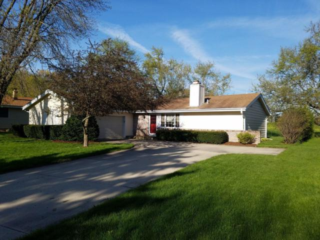 15449 W Mayflower Dr, New Berlin, WI 53151 (#1637451) :: RE/MAX Service First Service First Pros