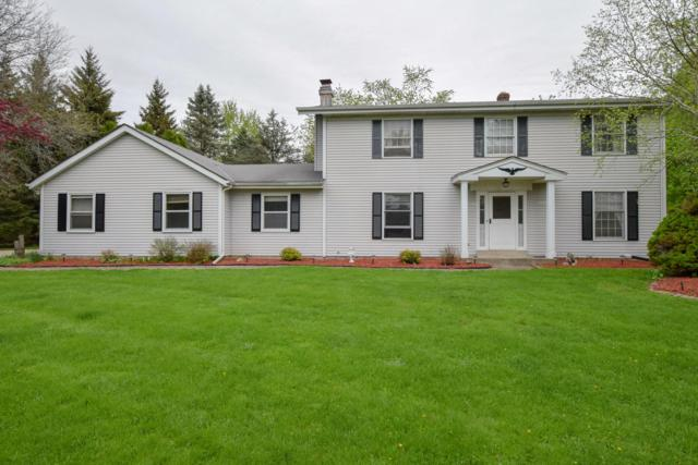 W271N1944 Fieldhack Dr, Pewaukee, WI 53072 (#1637703) :: RE/MAX Service First Service First Pros