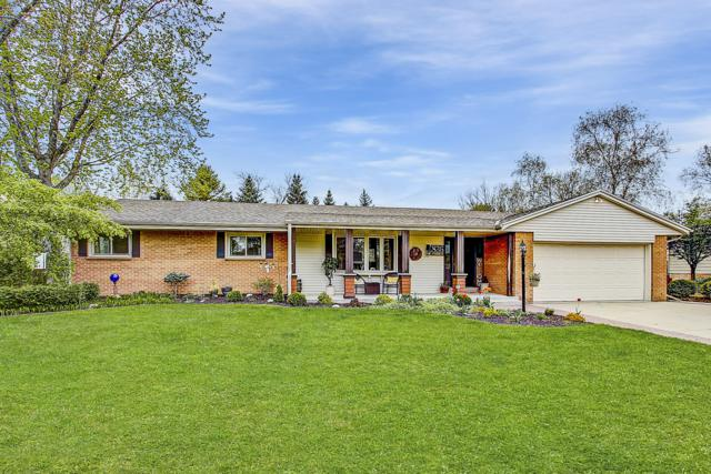 836 W Badger Ln, West Bend, WI 53095 (#1637812) :: RE/MAX Service First Service First Pros