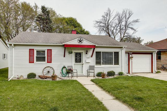1427 N 10th Ave, West Bend, WI 53090 (#1637825) :: RE/MAX Service First Service First Pros