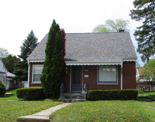 5887 N 34th, Milwaukee, WI 53209 (#1637855) :: RE/MAX Service First Service First Pros