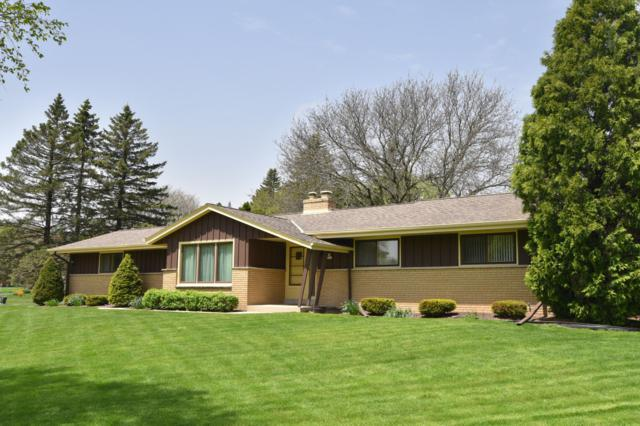 N68W14044 Oakwood Dr, Menomonee Falls, WI 53051 (#1639174) :: RE/MAX Service First Service First Pros