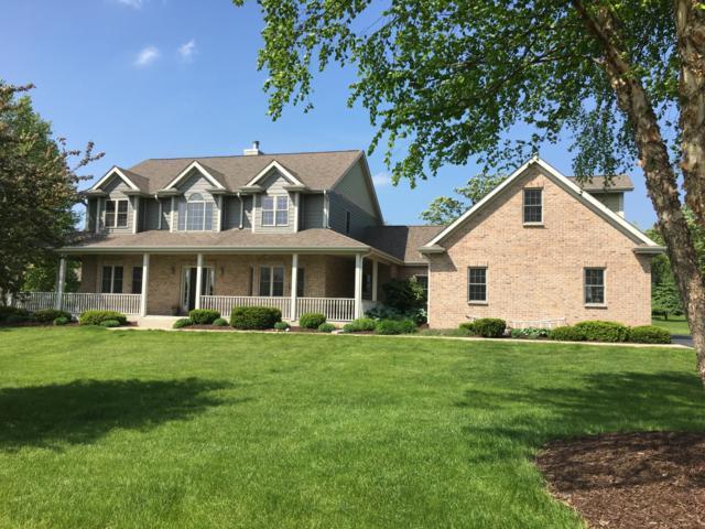 312 Cypress Pt, North Prairie, WI 53153 (#1641228) :: Tom Didier Real Estate Team