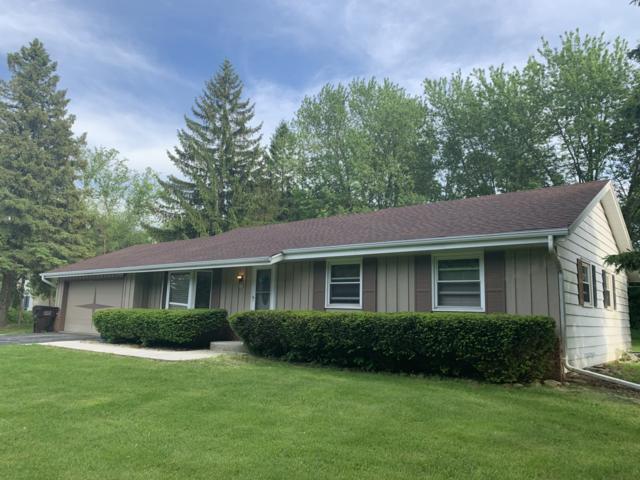 408 Prairie View Dr, North Prairie, WI 53153 (#1641482) :: Tom Didier Real Estate Team