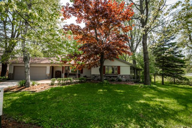4930 Upper Forest Beach Rd, Belgium, WI 53074 (#1641581) :: Tom Didier Real Estate Team