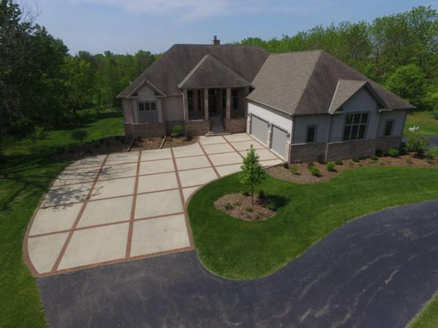 12973 N Fox Hollow, Mequon, WI 53097 (#1642502) :: Tom Didier Real Estate Team