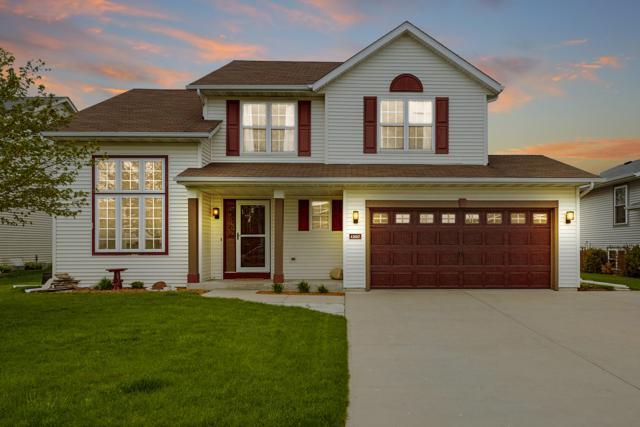 1207 Center St, Hartford, WI 53027 (#1642561) :: Tom Didier Real Estate Team