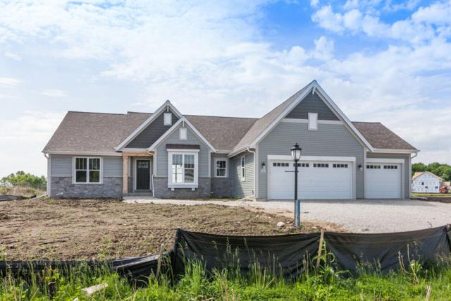W223N4664 Seven Oaks Dr, Pewaukee, WI 53072 (#1643045) :: RE/MAX Service First Service First Pros