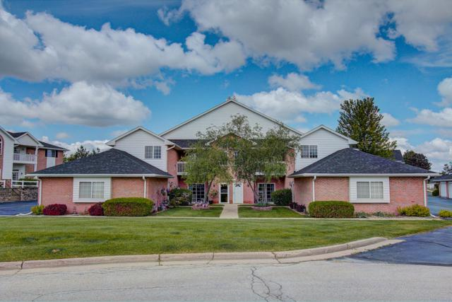 W241N2531 E Parkway Meadow Cir #8, Pewaukee, WI 53072 (#1643093) :: RE/MAX Service First Service First Pros
