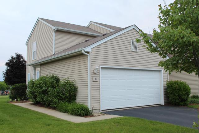 1400 Hunters Ridge Dr #94, Genoa City, WI 53128 (#1644697) :: RE/MAX Service First Service First Pros