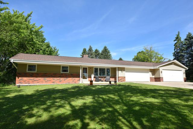 769 River Bend Rd, Grafton, WI 53024 (#1645724) :: RE/MAX Service First Service First Pros