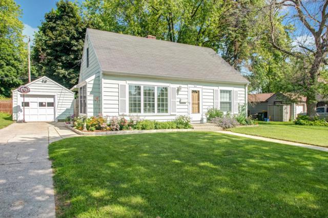 214 Hawthorn Dr, West Bend, WI 53095 (#1647488) :: Tom Didier Real Estate Team