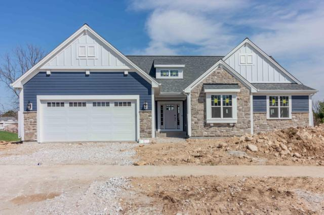 W235N6568 Outer Circle Dr, Sussex, WI 53089 (#1647624) :: Tom Didier Real Estate Team
