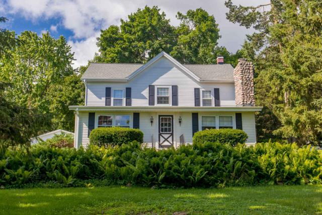 N42W27317 Capitol Dr, Pewaukee, WI 53072 (#1648429) :: RE/MAX Service First Service First Pros