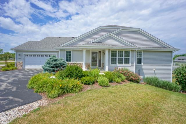 N52W35292 Lighthouse Ln, Oconomowoc, WI 53066 (#1648590) :: RE/MAX Service First Service First Pros