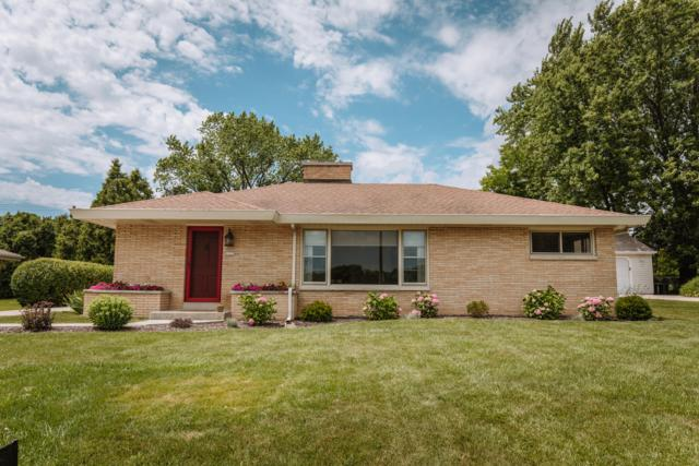 2225 N 122nd St, Wauwatosa, WI 53226 (#1648869) :: RE/MAX Service First Service First Pros
