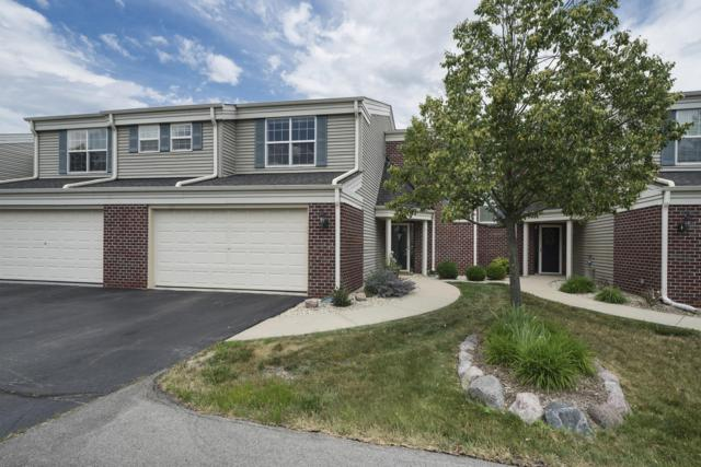 N15W26510 Golf View Ln F, Pewaukee, WI 53072 (#1649220) :: RE/MAX Service First Service First Pros