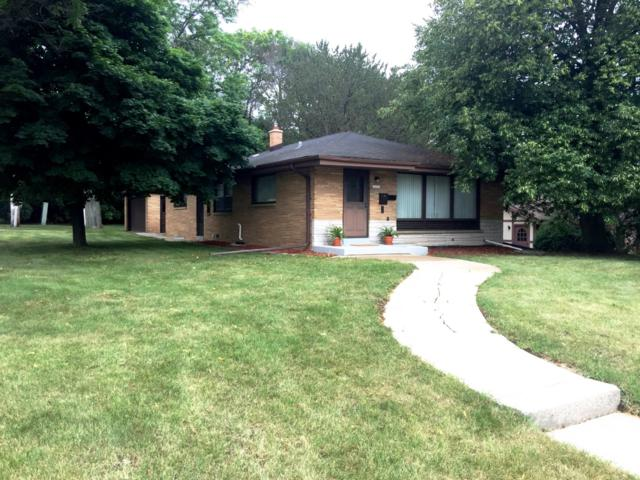 10203 W Capitol Dr, Wauwatosa, WI 53222 (#1649394) :: RE/MAX Service First Service First Pros