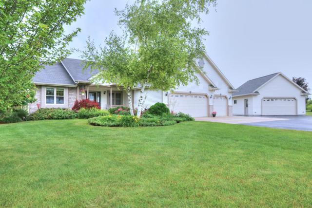 15010 S Cedar Lake Rd, Schleswig, WI 53042 (#1649424) :: RE/MAX Service First Service First Pros