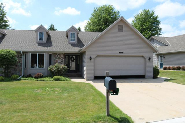 1410 Ridgewood Dr, West Bend, WI 53095 (#1649630) :: RE/MAX Service First Service First Pros