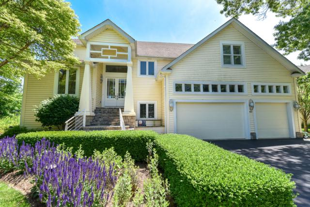 8717 Lakeshore Dr, Pleasant Prairie, WI 53158 (#1652159) :: RE/MAX Service First Service First Pros