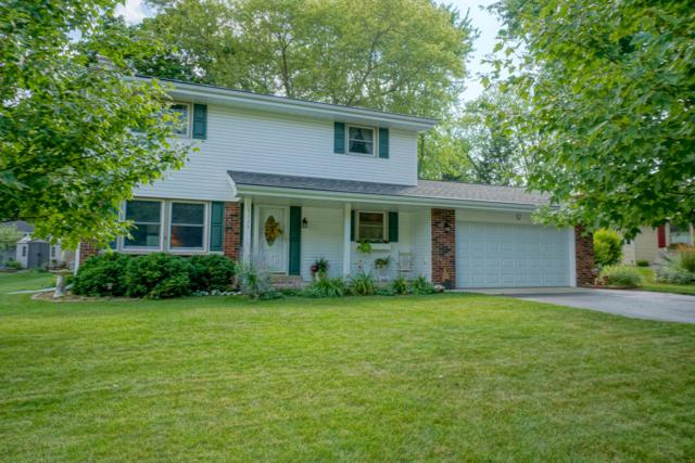 1129 Dona Rd, Hartland, WI 53029 (#1652417) :: RE/MAX Service First