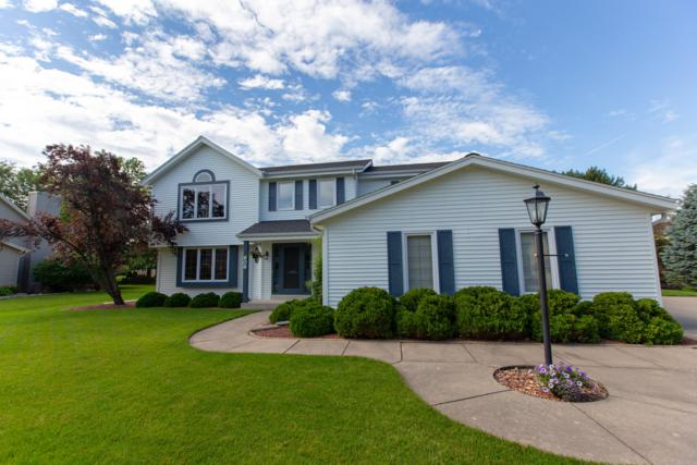 606 Greenway Ter, Hartland, WI 53029 (#1653579) :: RE/MAX Service First
