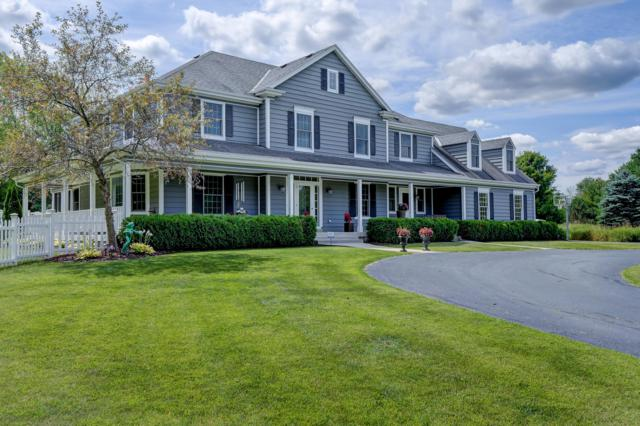 12205 W Bonniwell Rd, Mequon, WI 53097 (#1653758) :: eXp Realty LLC