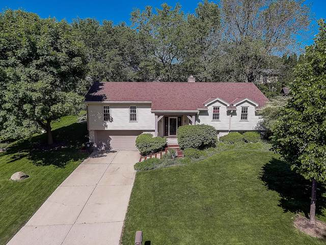 1057 N 123rd St, Wauwatosa, WI 53226 (#1658837) :: RE/MAX Service First Service First Pros