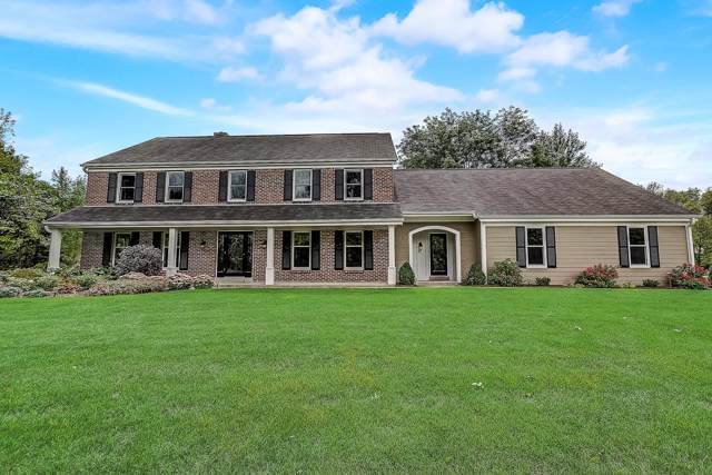 1719 W Thrush Ln, Mequon, WI 53092 (#1659019) :: RE/MAX Service First Service First Pros