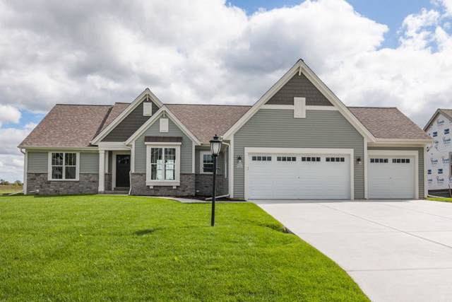 W223N4664 Seven Oaks Dr, Pewaukee, WI 53072 (#1660702) :: Tom Didier Real Estate Team