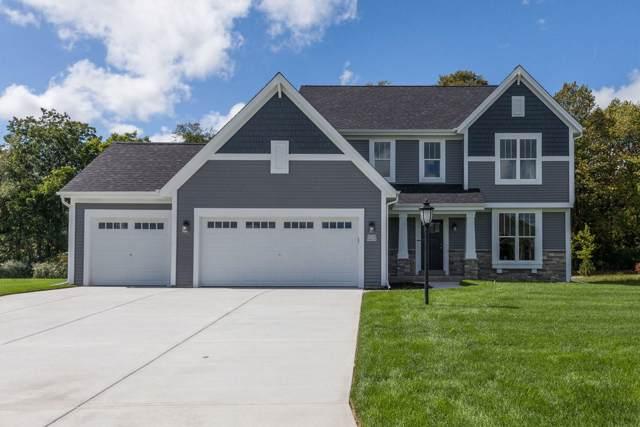 W224N4535 Seven Oaks Dr, Pewaukee, WI 53072 (#1660732) :: Tom Didier Real Estate Team