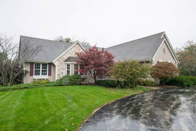 7915 N Mohawk Rd, Fox Point, WI 53217 (#1662967) :: Tom Didier Real Estate Team