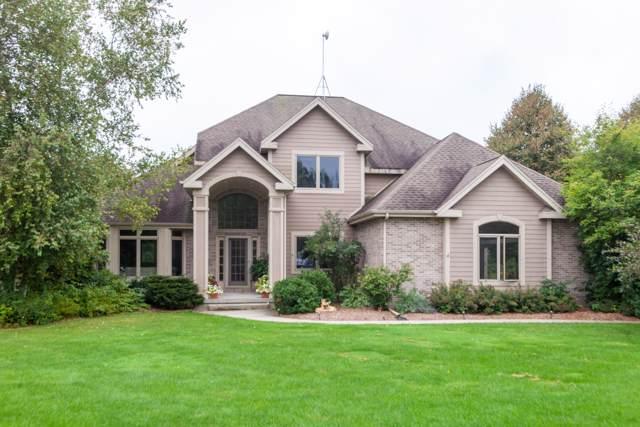 3650 Cedar Creek Ct, Polk, WI 53037 (#1664068) :: Tom Didier Real Estate Team