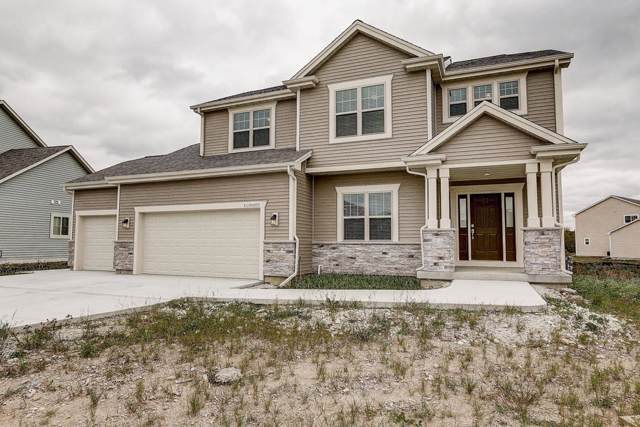 W153N4892 Orchid Cir, Menomonee Falls, WI 53051 (#1664561) :: Tom Didier Real Estate Team