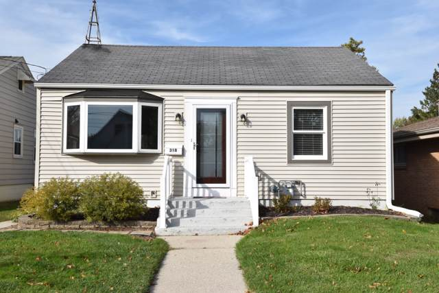 318 E Kilbourn Ave, West Bend, WI 53095 (#1664965) :: RE/MAX Service First Service First Pros