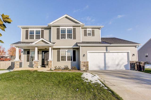 322 Oakbrook Dr, Lake Mills, WI 53551 (#1666051) :: Tom Didier Real Estate Team