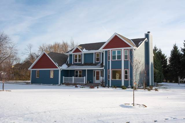 N68W28021 Steepleview Ln, Merton, WI 53029 (#1666342) :: RE/MAX Service First Service First Pros