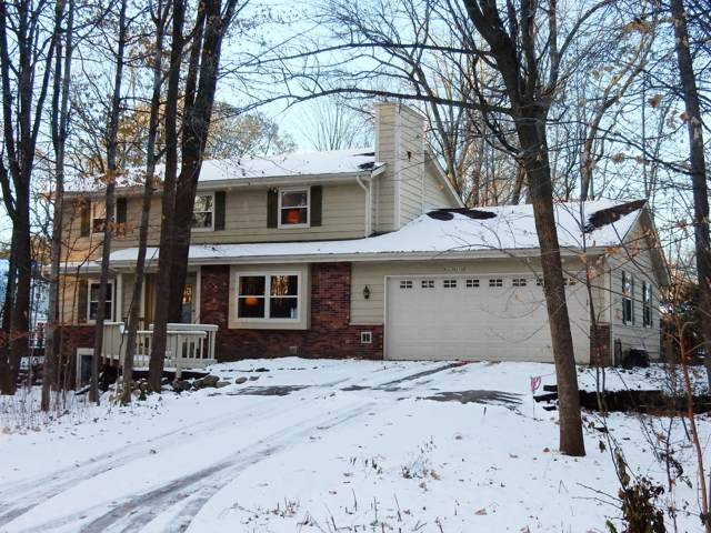 W221N2730 Timberwood Ln, Pewaukee, WI 53186 (#1667792) :: RE/MAX Service First Service First Pros
